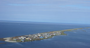 island of kivalina with houses on it
