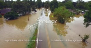 305 Dramatic aerial flyover water flooding highway and neighborhood after rain storm